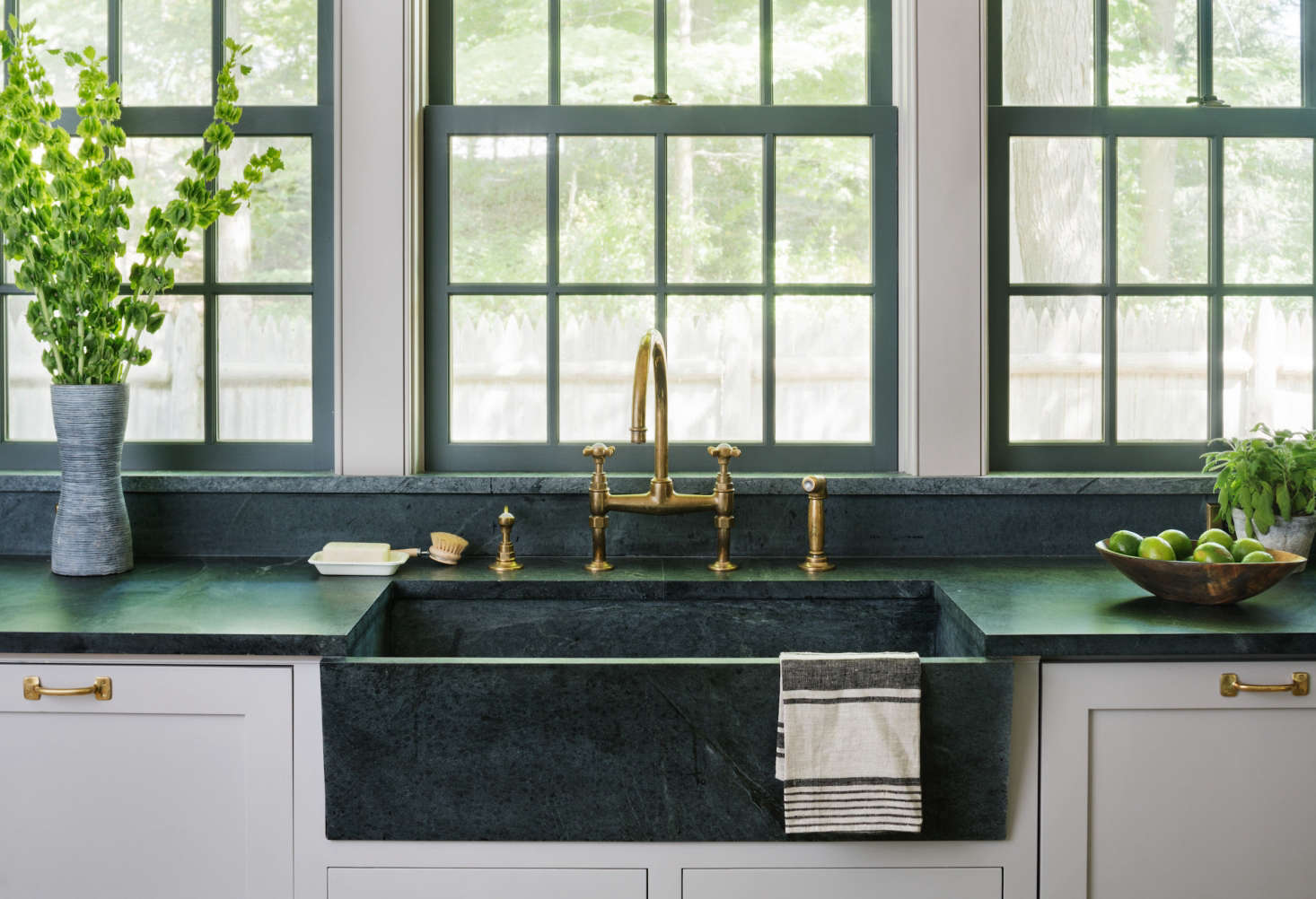 An angled soapstone sink in Architect Visit: A Renovated Farmhouse in Bedford with Scandinavian Influences.