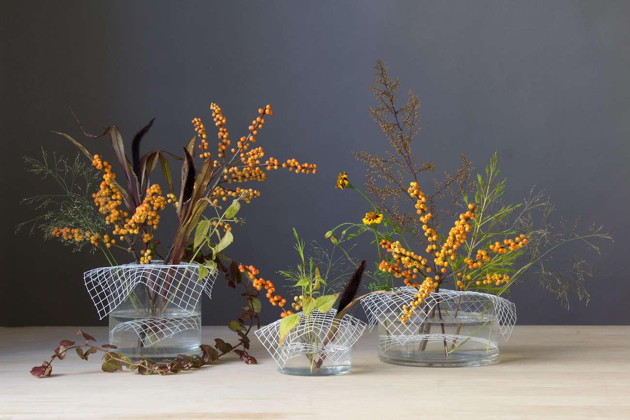 modern flower arrangements with orange berries for thanksgiving david stark 13