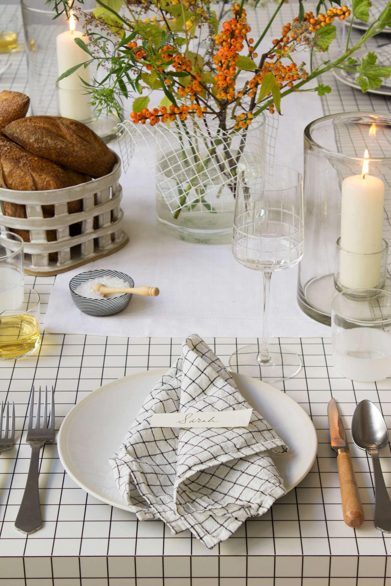 modern thanksgiving table setting grids orange flowers black white david stark 10