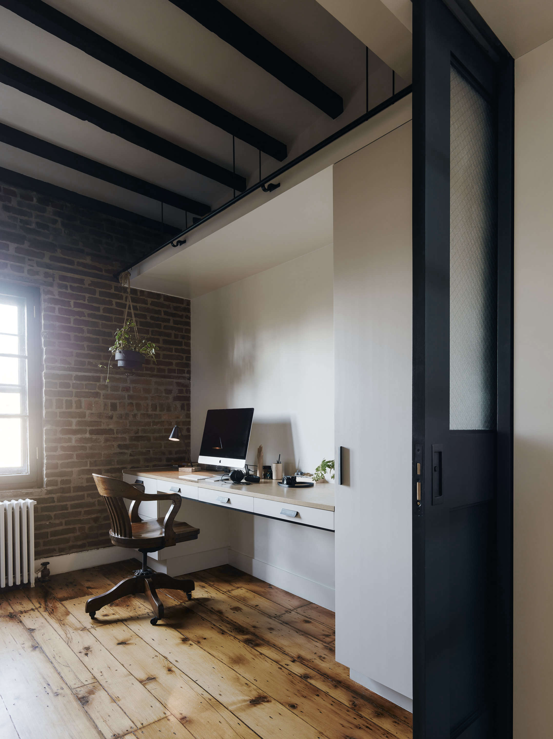 office in brooklyn with wood floors ceiling beams general assembly