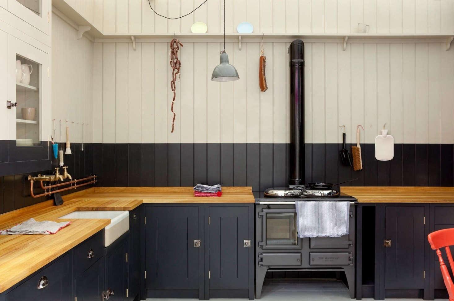 A butcher block countertop in a British Standard Cupboard Kitchen by Plain English.
