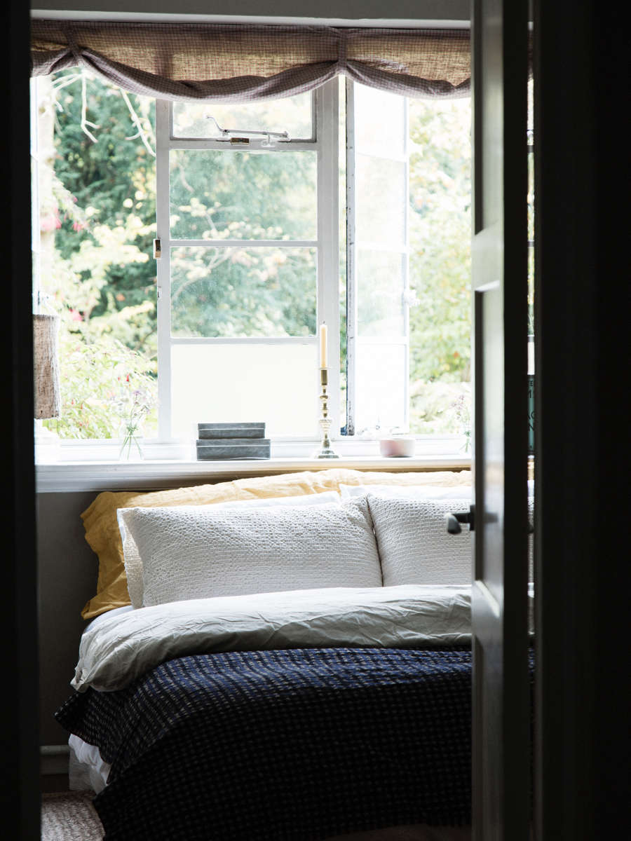 bedroom with linen curtains and linen bedsheets