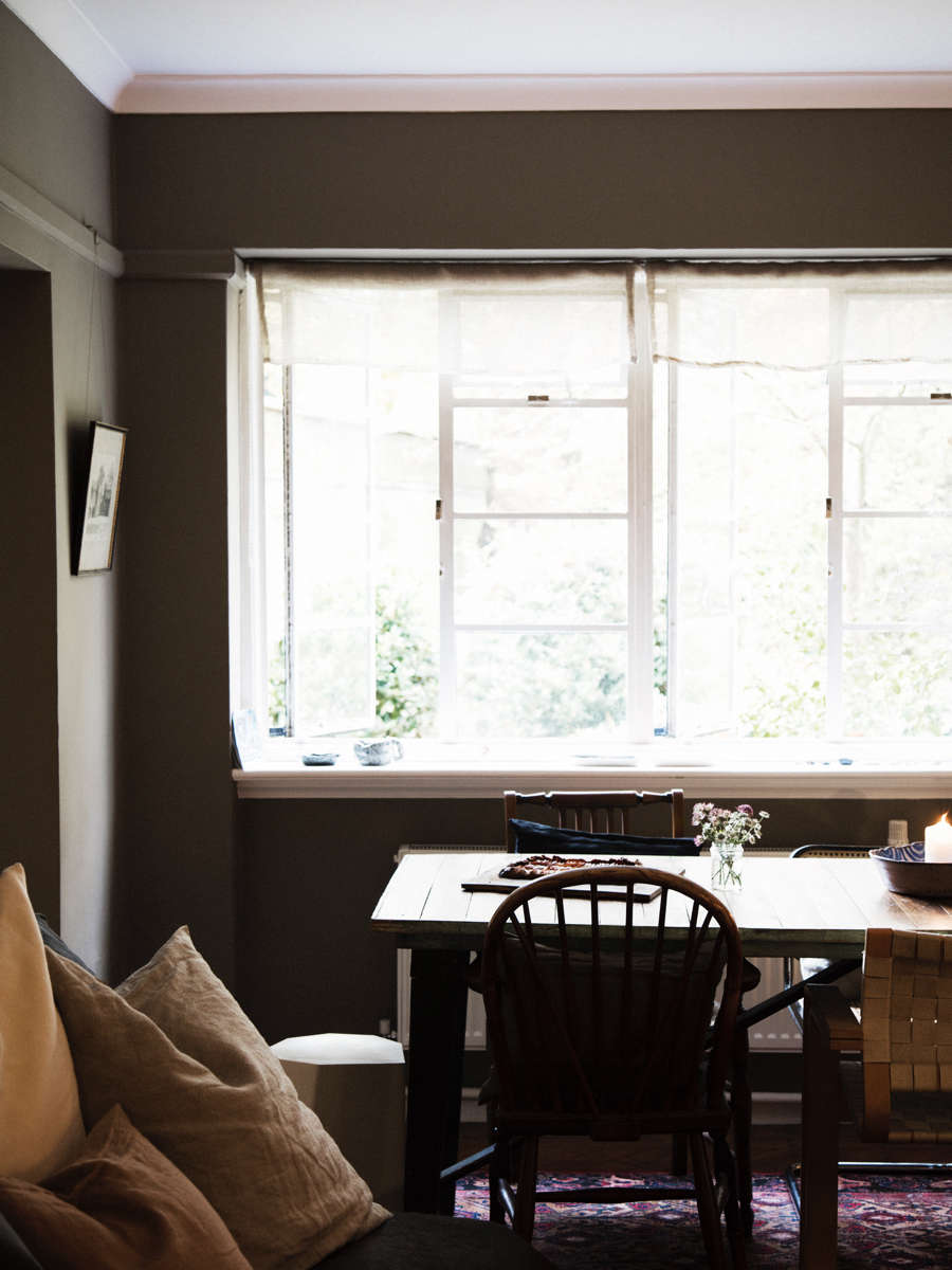 soft lght coming through dining room with wood table