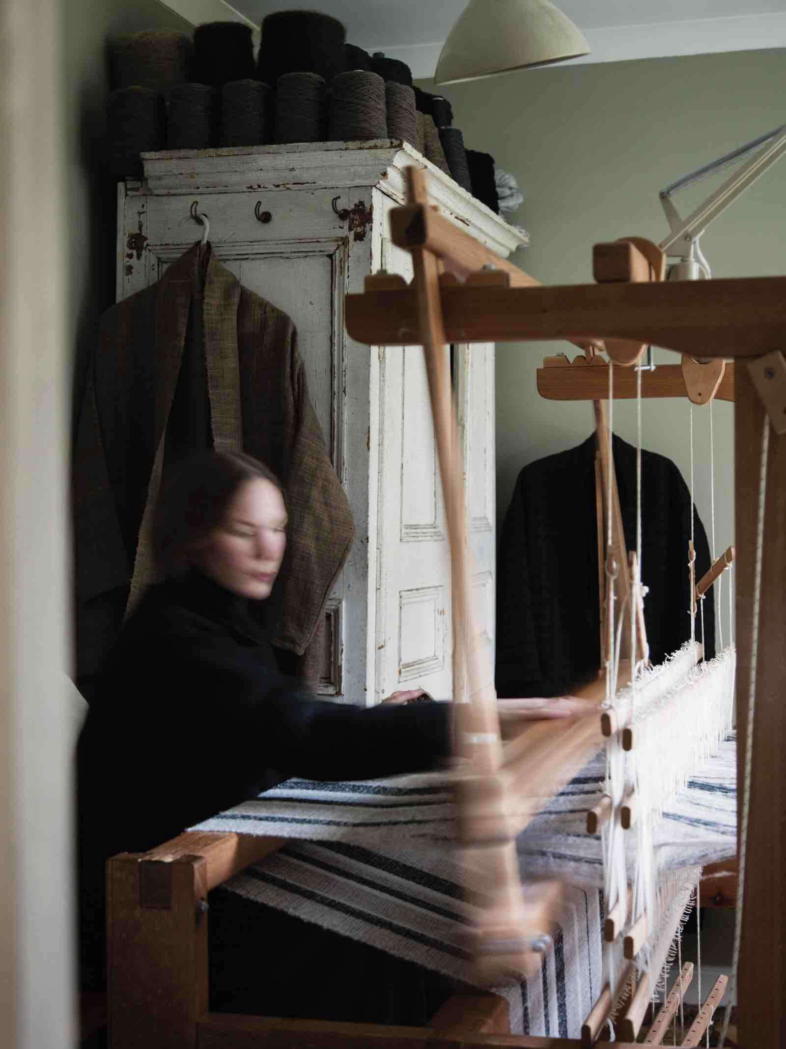 Amy Revier weaving at her loom