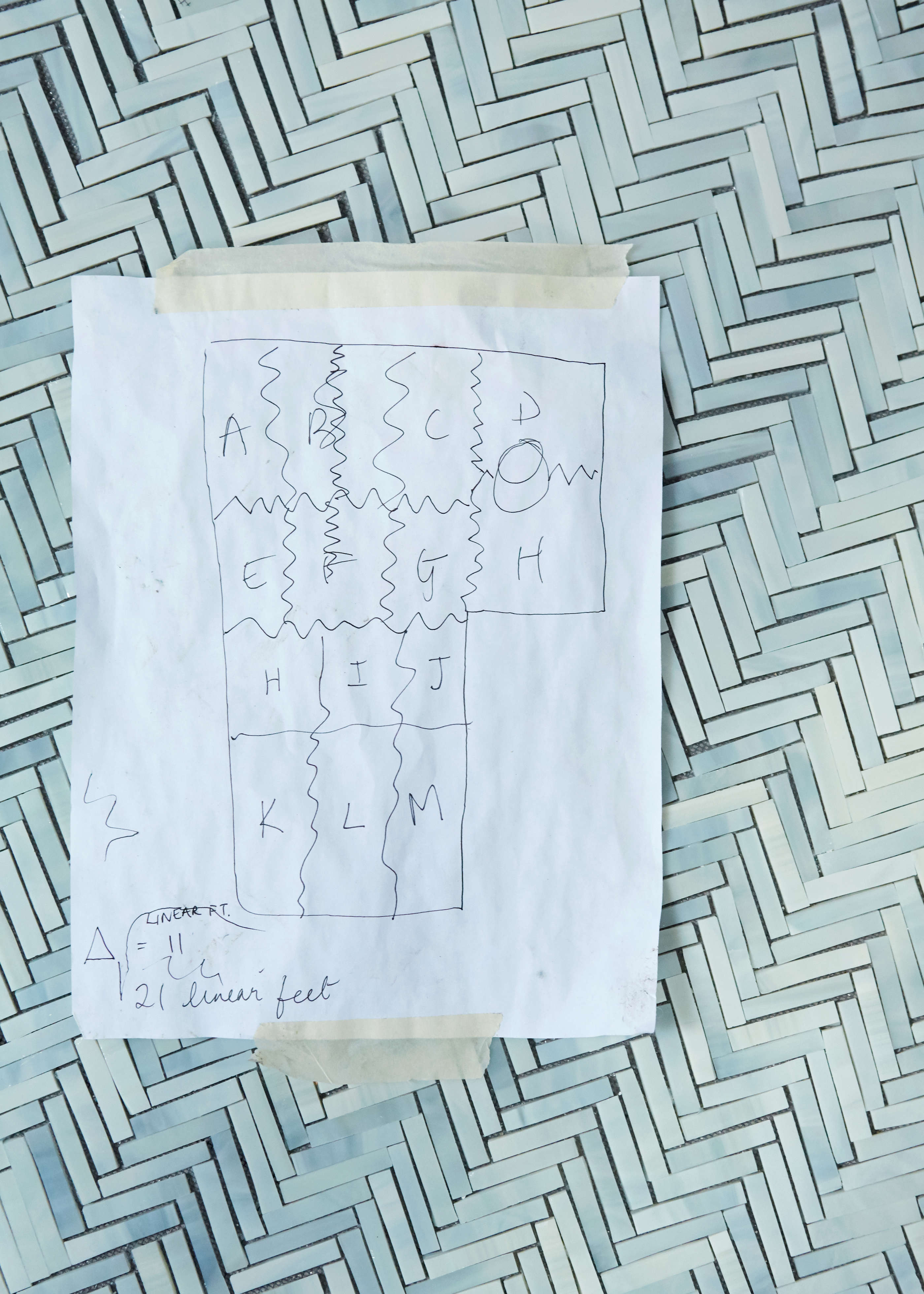 In her studio, Myers adheresthe pattern onto a fiberglass mesh that she then cuts into outsized puzzle-like pieces—each labeled with a corresponding letter—for transport to the site. Shown here is a map of how she broke up the floor.