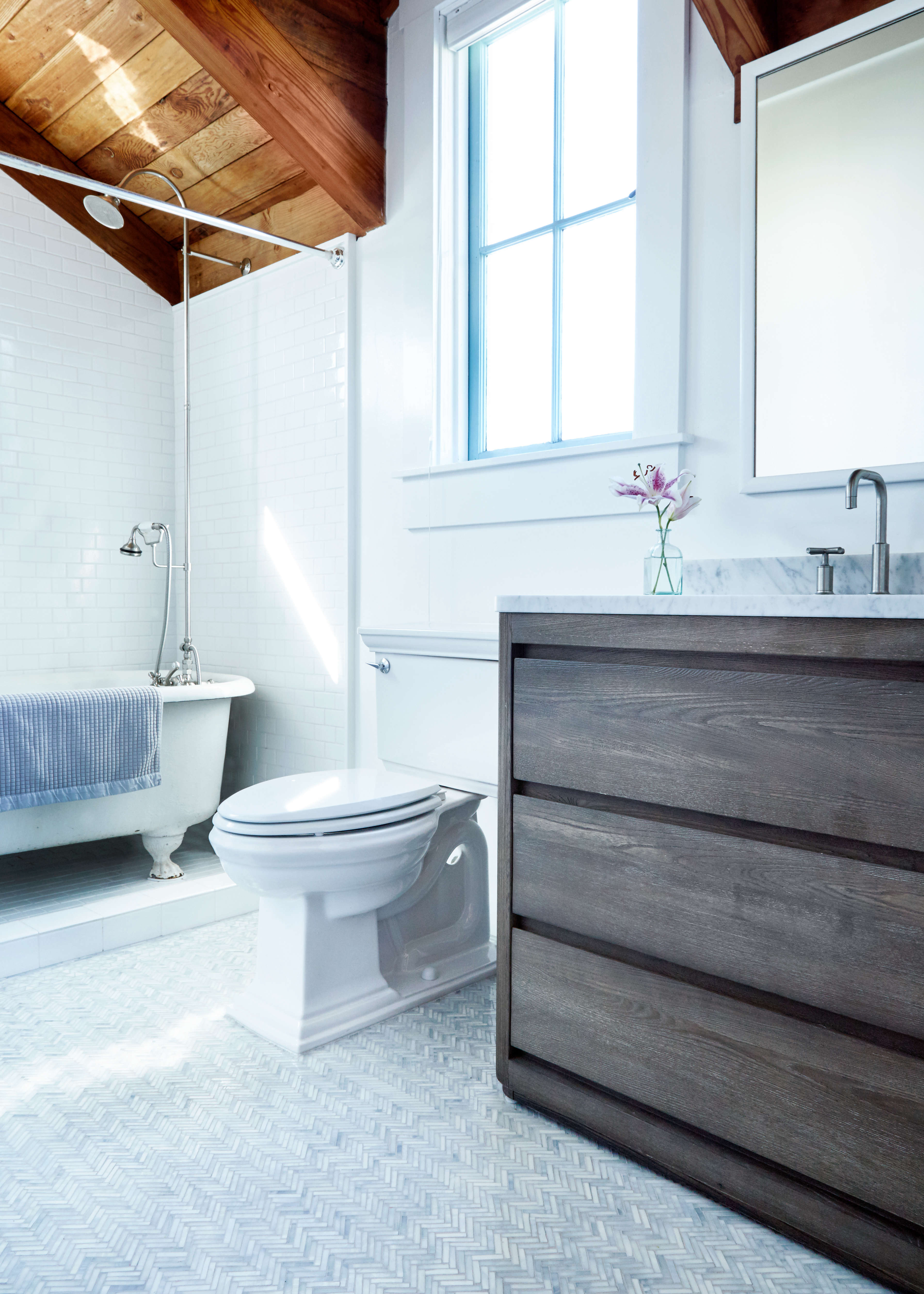 Myers does most of the tile work in her studio in Inverness. But before that could beginthe couple had their trusted contractor, Sallie Lang of Bliss Design Build, get the room refreshed and ready. That included installingsubway tile (Daltile in Arctic White) around the existing clawfoot tub as well as a new watering can shower head and hand faucet in brushed nickel (by Randolph Morris) and painting the walls Benjamin Moore Super White.