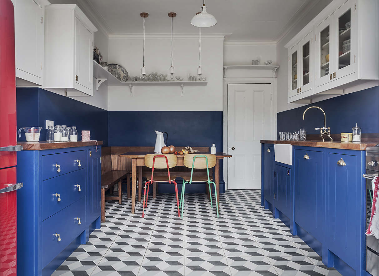 A booth-style seating area designed from antique church pews in the British Standard-designed kitchen fromKitchen of the Week: A Brightly Colored (and Cost Conscious) London Kitchen.