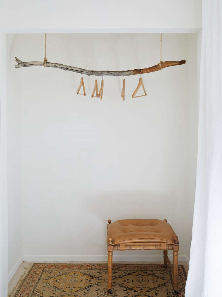 The New Rusticity 11 DIY Ways to Use Branches Indoors A particularly artful use: branch as clothes rack inThe Joshua Tree Casita: A Stylish DIY Remodel, Budget Edition.