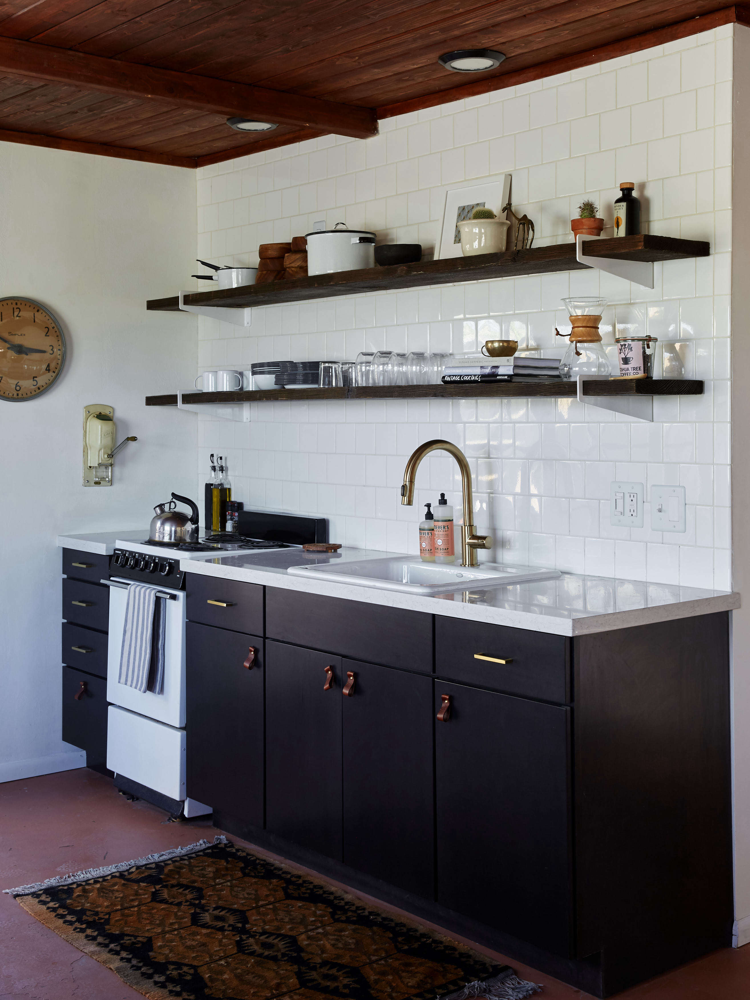 13 Favorite CostConscious Kitchen Remodels from the Remodelista Archives Joshua Tree Casita Airbnb Black Kitchen Cabinets Kate Sears