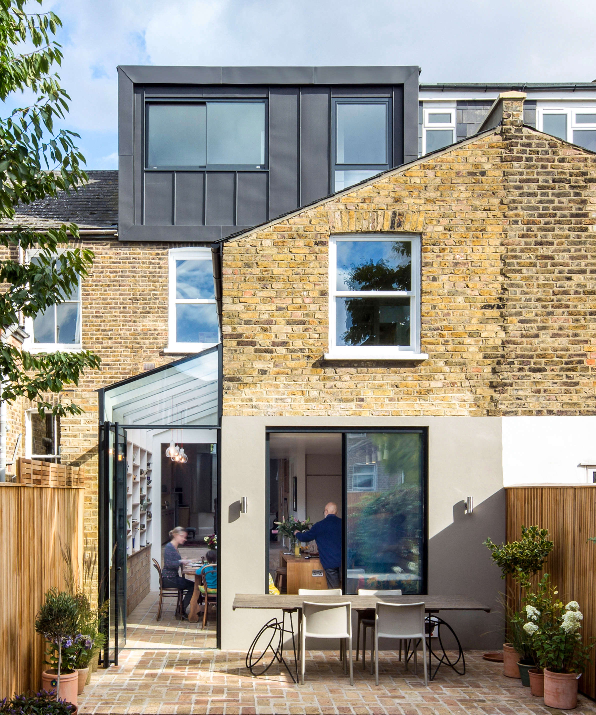 set in the back of the house, the new kitchen features a glazed extension that  9