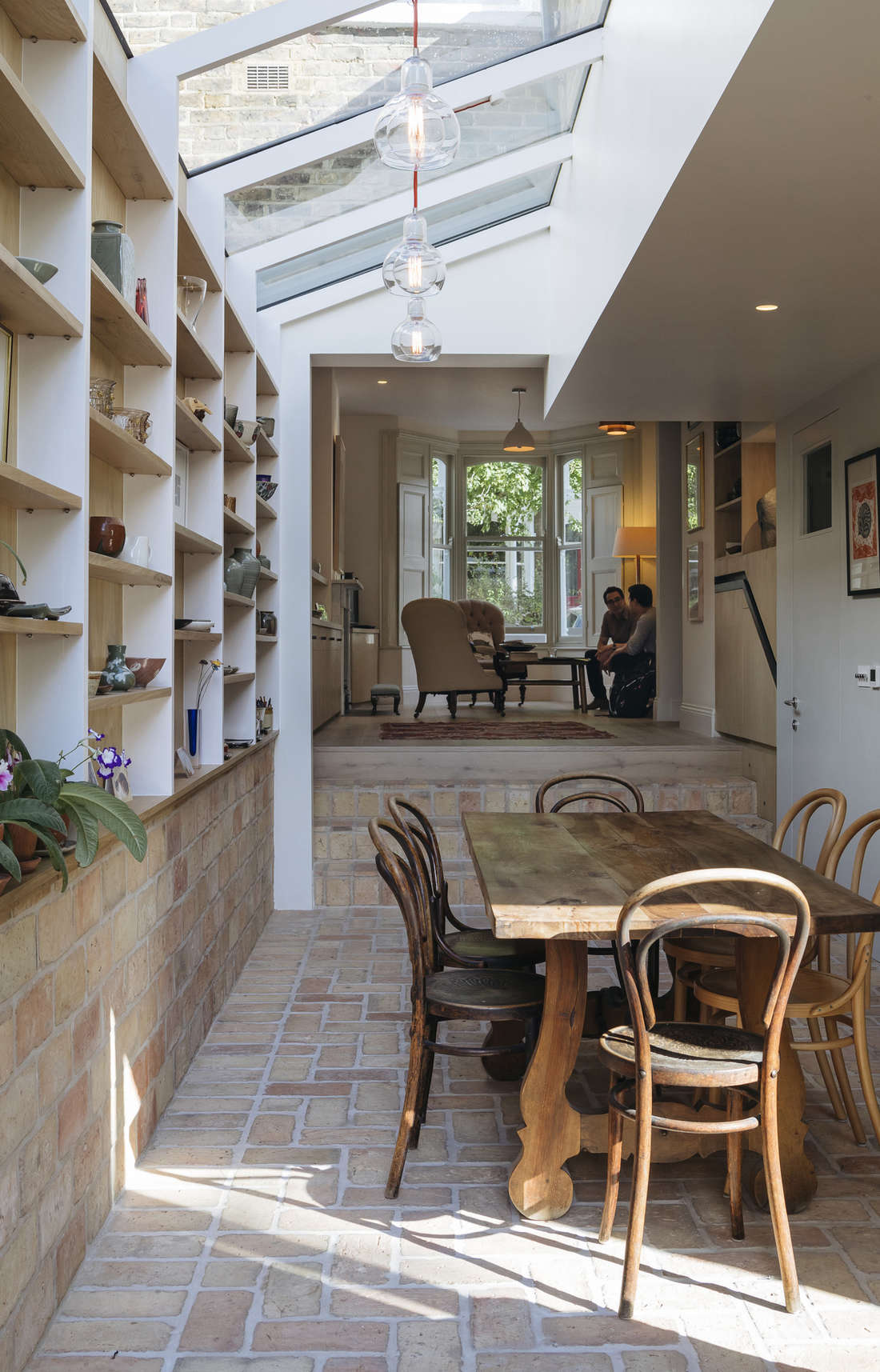 formerly divided into separate kitchen, dining, and living rooms, the three are 15