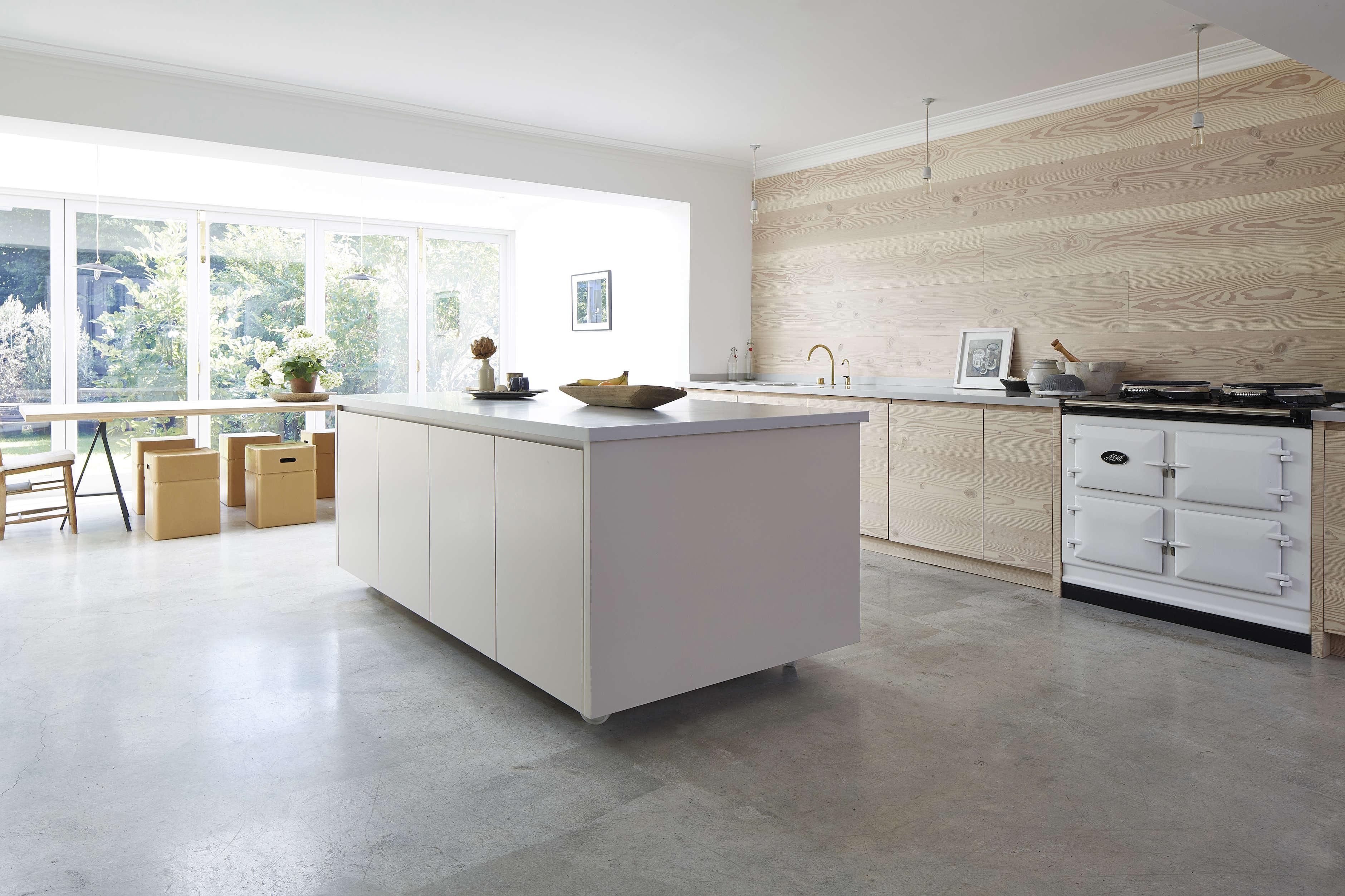 white minimalist kitchen island and window wall addition in a scandinavian pale 9