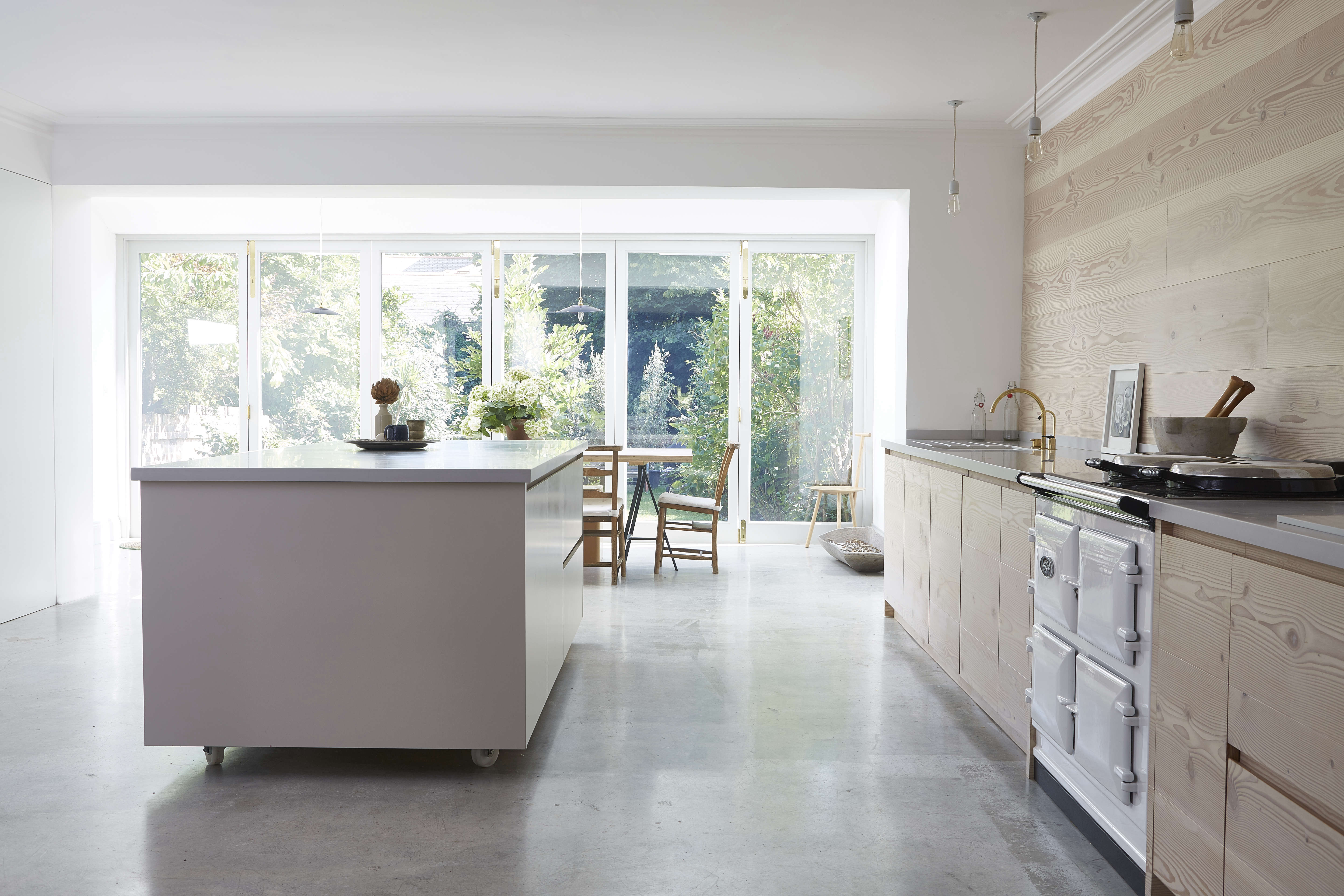 clean lined white kitchen island and polished concrete floor in a scandinavian  12