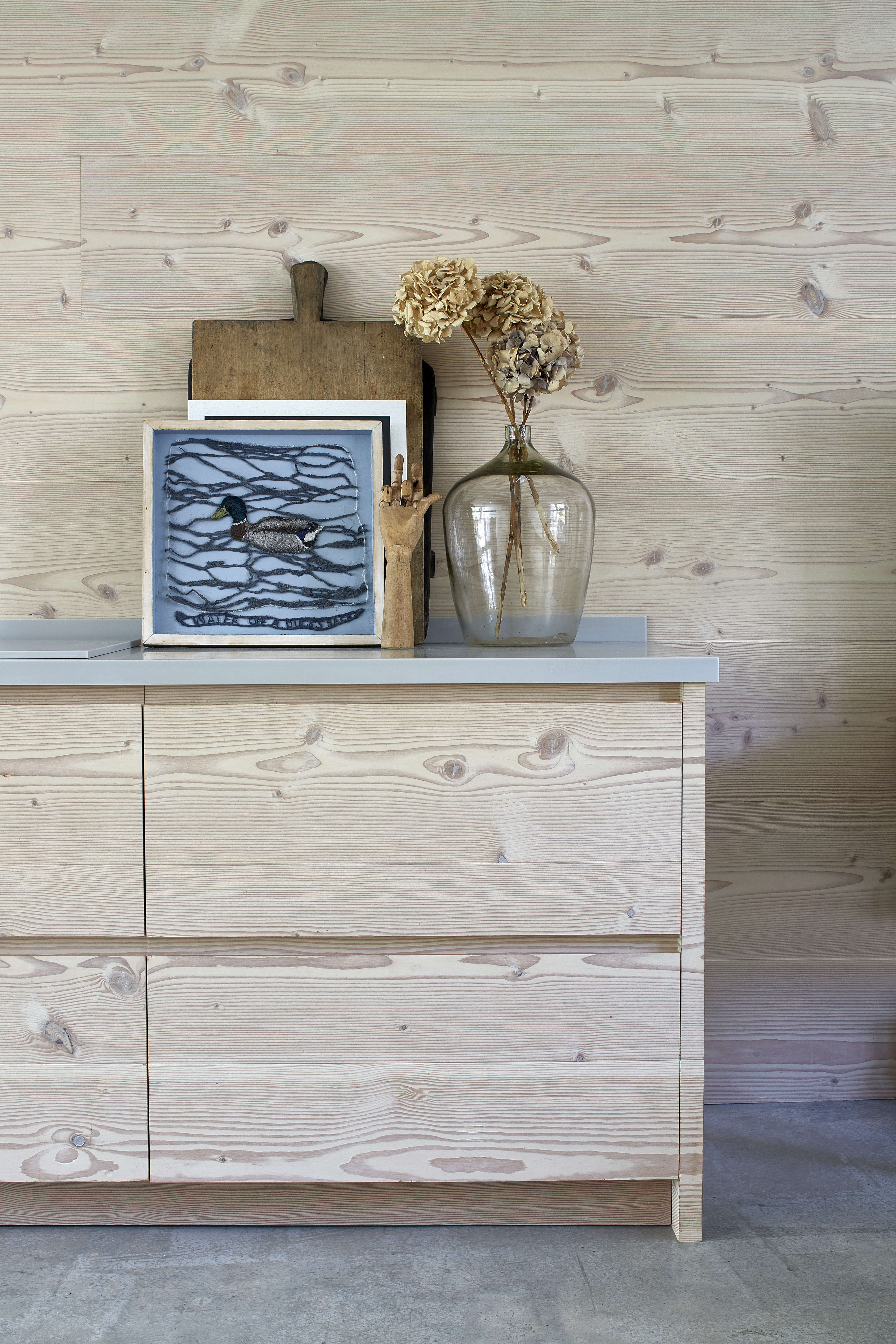 dougls fir cabinets and wall paneling—and an artful countertop display—in a 14