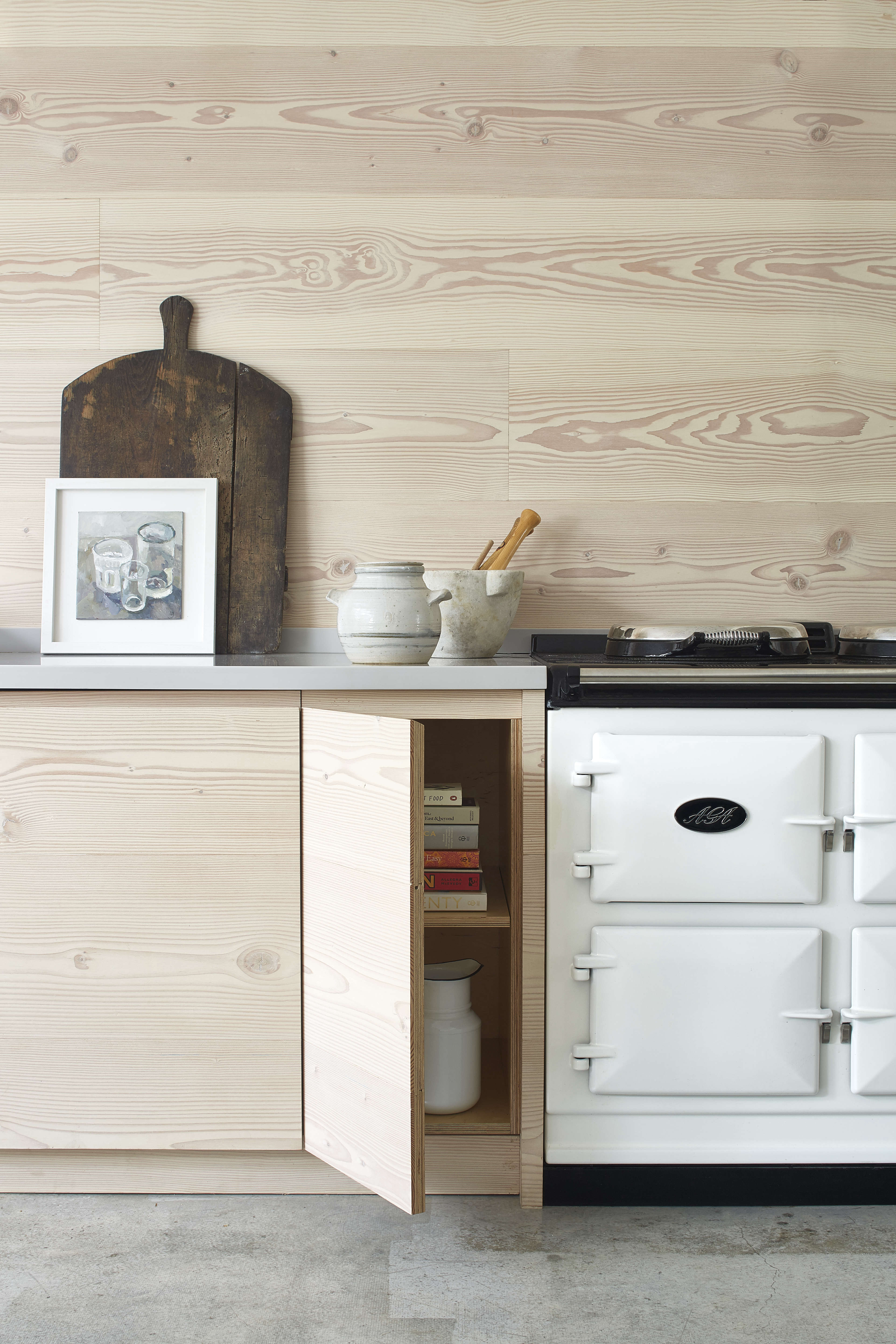dougls fir cabinets and wall paneling and a white aga in a scandinavian pale wo 15