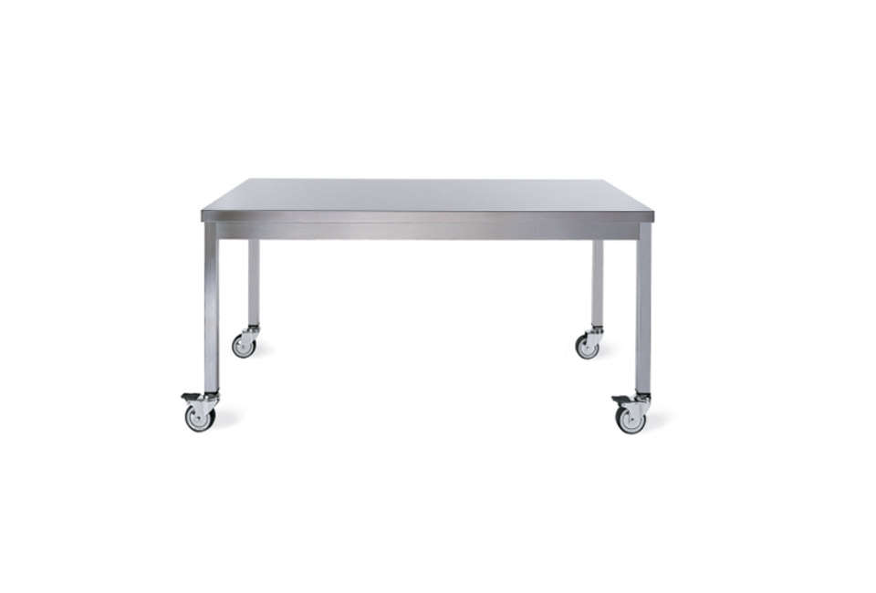 Designed by Giulio Lazzotti, the Quovis Table in stainless steel has lockable casters; $loading=