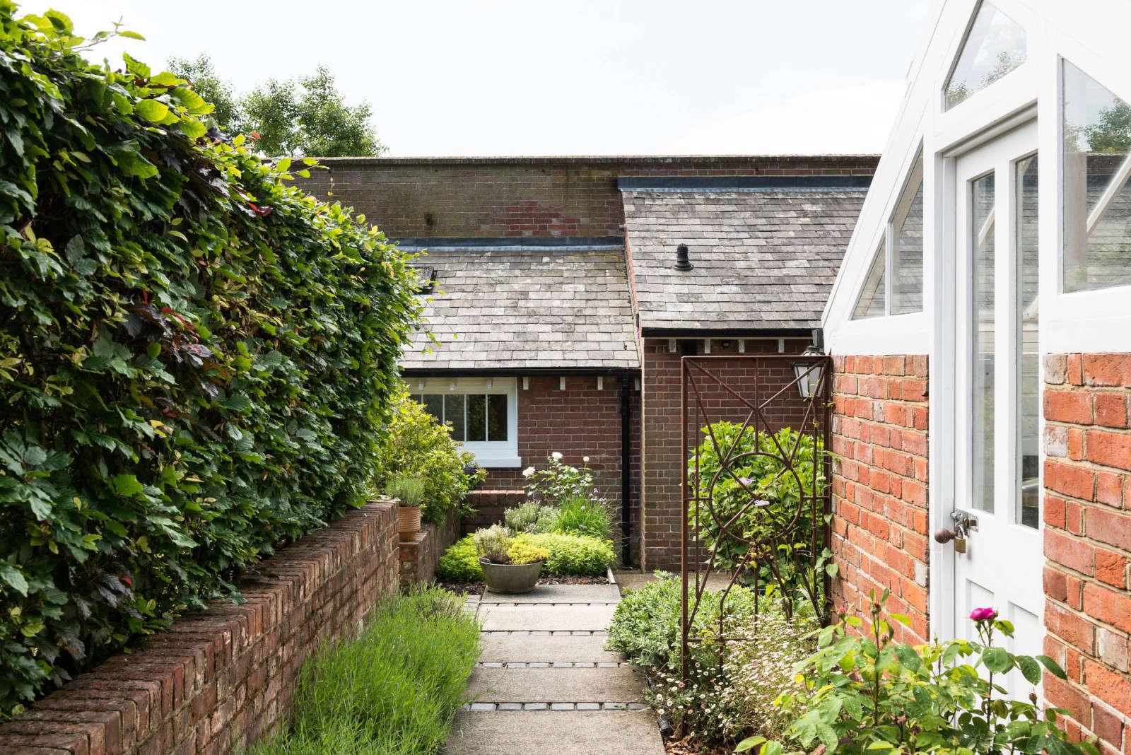 Greenhouse Conversion Kent The Modern House Brick Wall