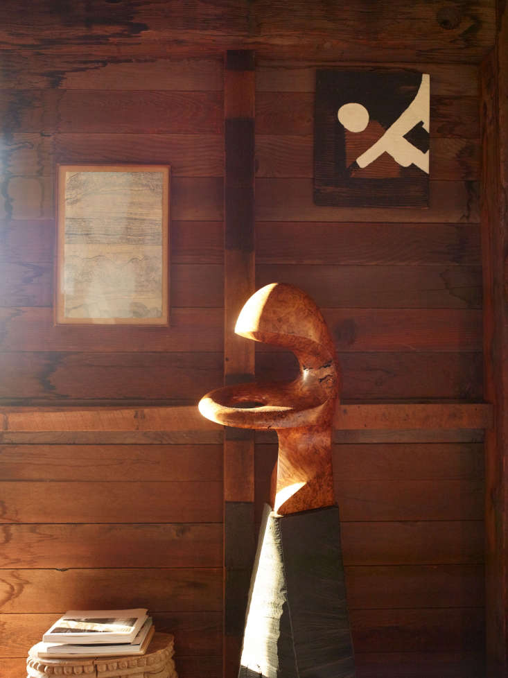 Blunk House Inside a Masters Sculptural Homestead Hewn by Hand in Northern California A wooden sculpture by the doorway.