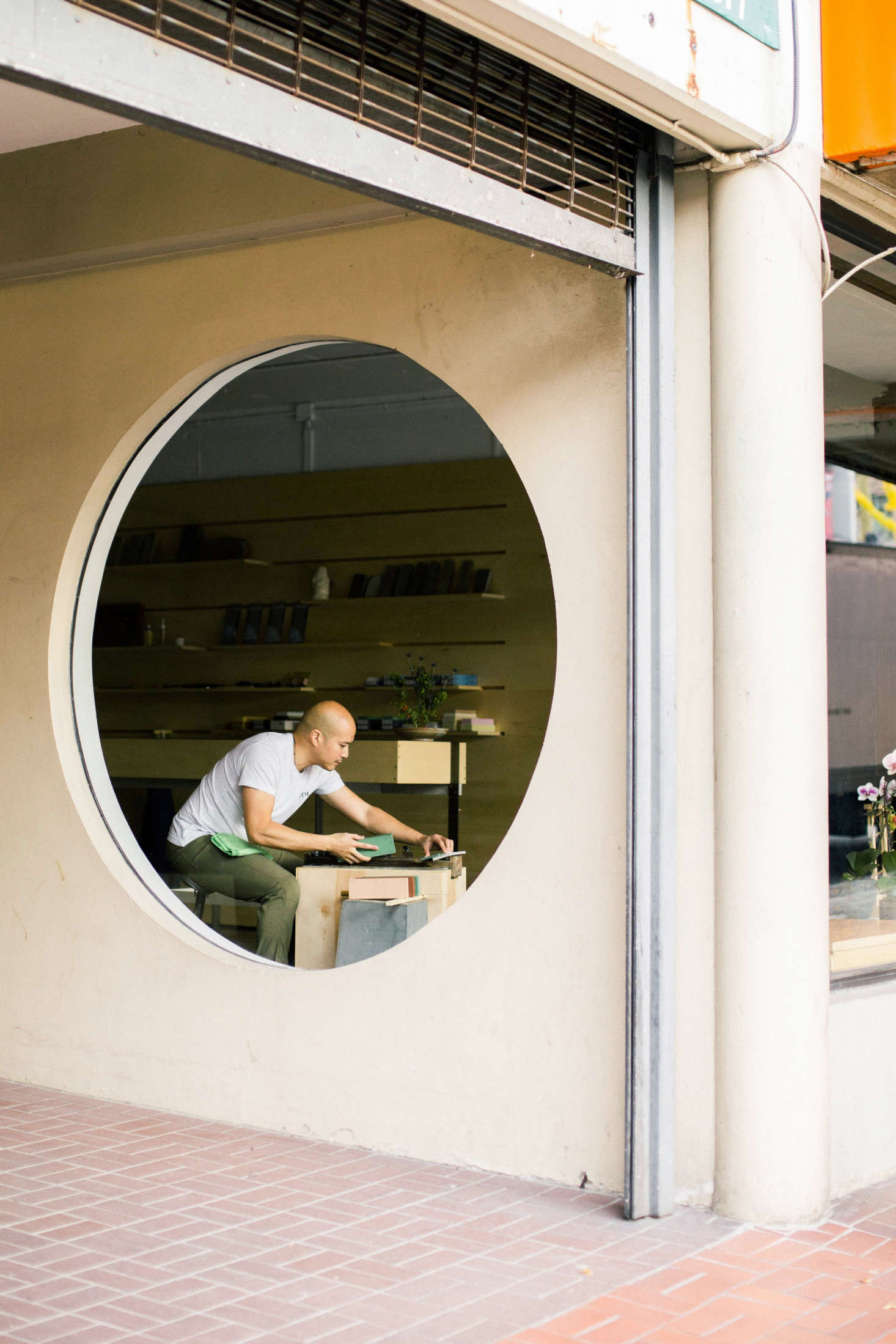 Circular Window in Ai and Om Knife Shop by Scott and Scott Architects