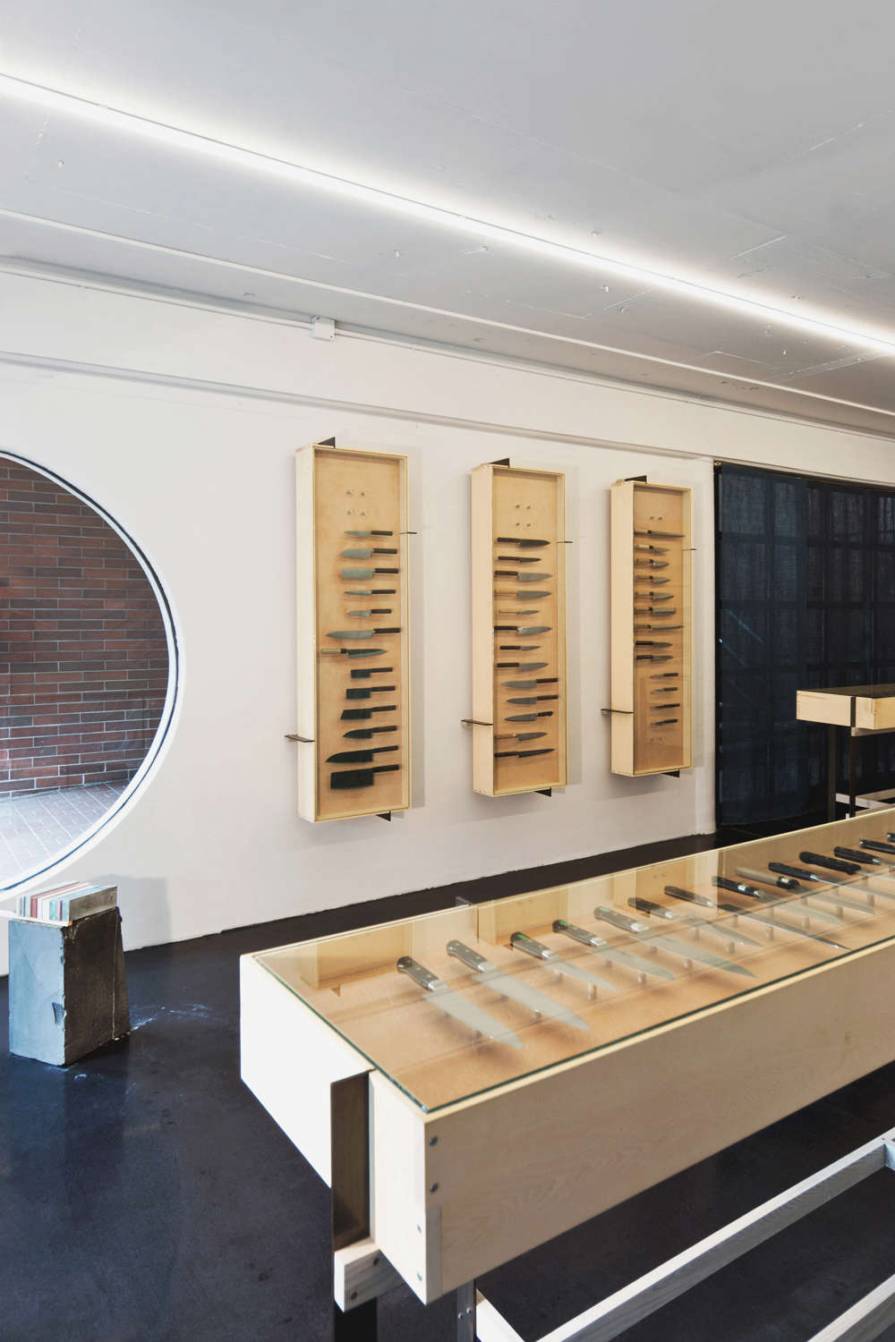 Display Cases in Ai and Om Knife Shop by Scott and Scott Architects