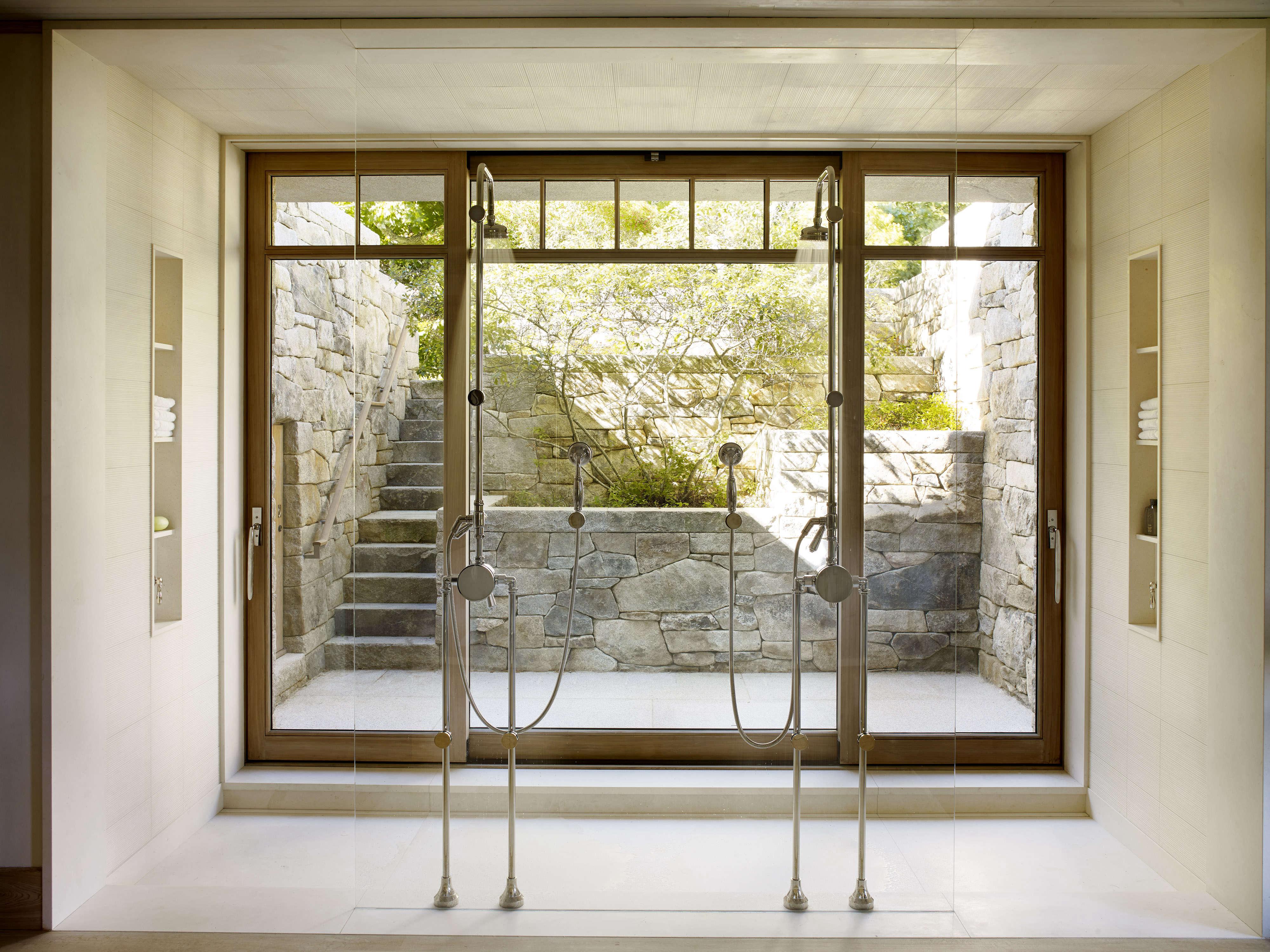 shower-opens-onto-backyard-greenery-light-open