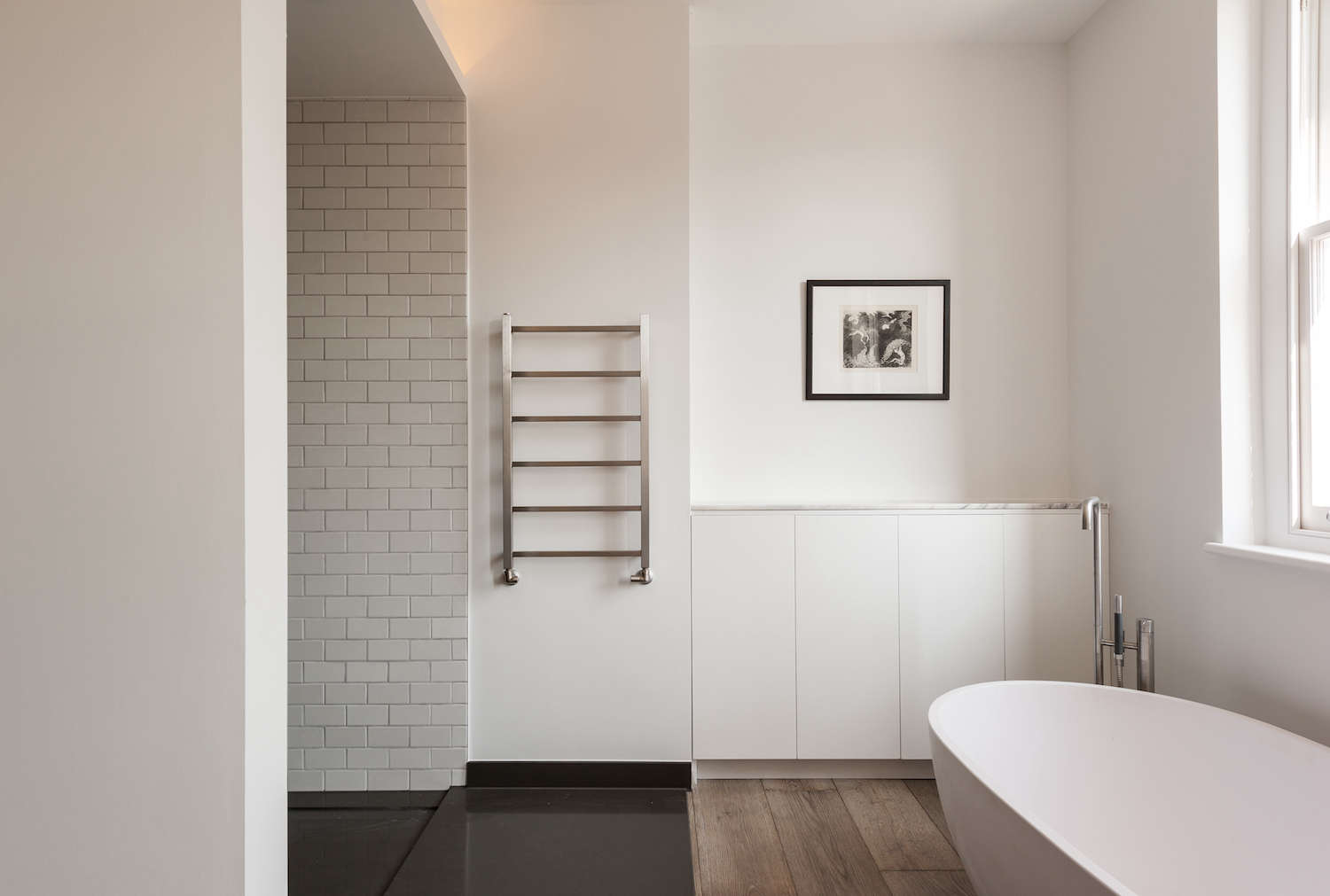 subway tile shower in modern white uk bathroom with stainless towel heater 16