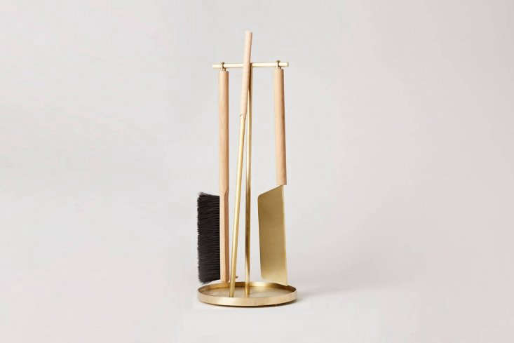 the set, shown inbrushed brass with oak,includes a poker modeled aftera t 10