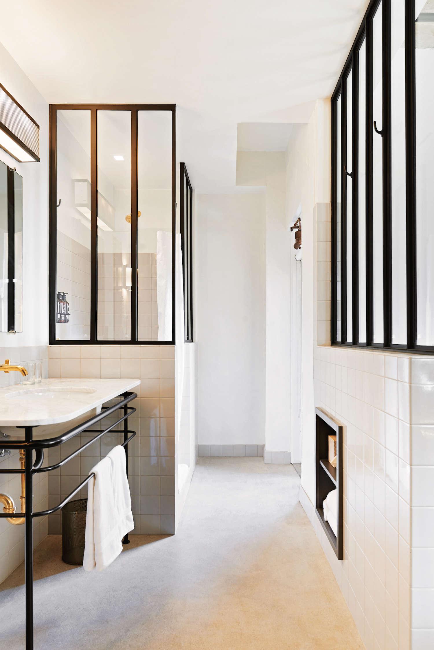 white-bathroom-with-black-steel-interior-windows