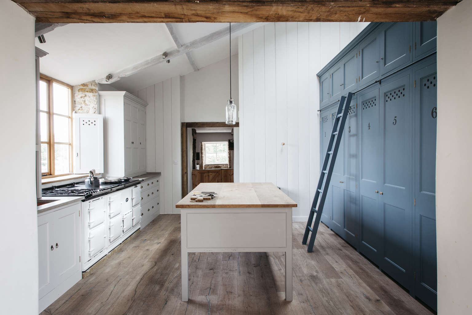 Blue kitchen cabinets in a modern spin on a classic English kitchen by Plain English