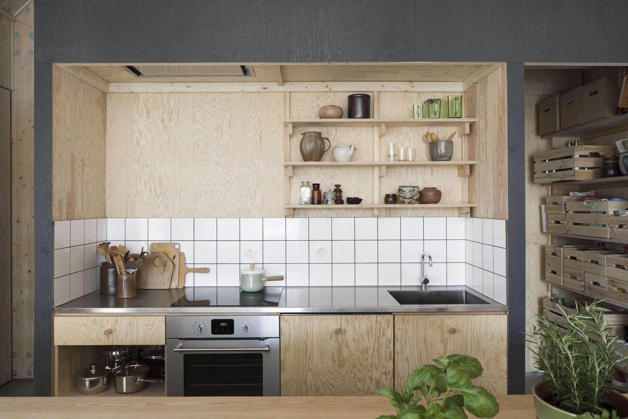 A tiny kitchen in southern Sweden with an electric cooktop that almost disappears on the stainless counter from Kitchen of the Week: A Cost-Conscious Kitchen in Sweden.