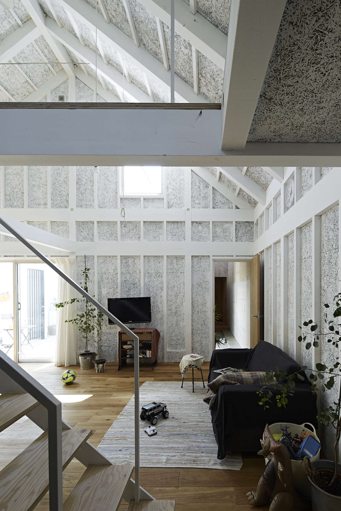 the living area at sabi, a surfers' house in chiba, japan, designed by no. 555  16