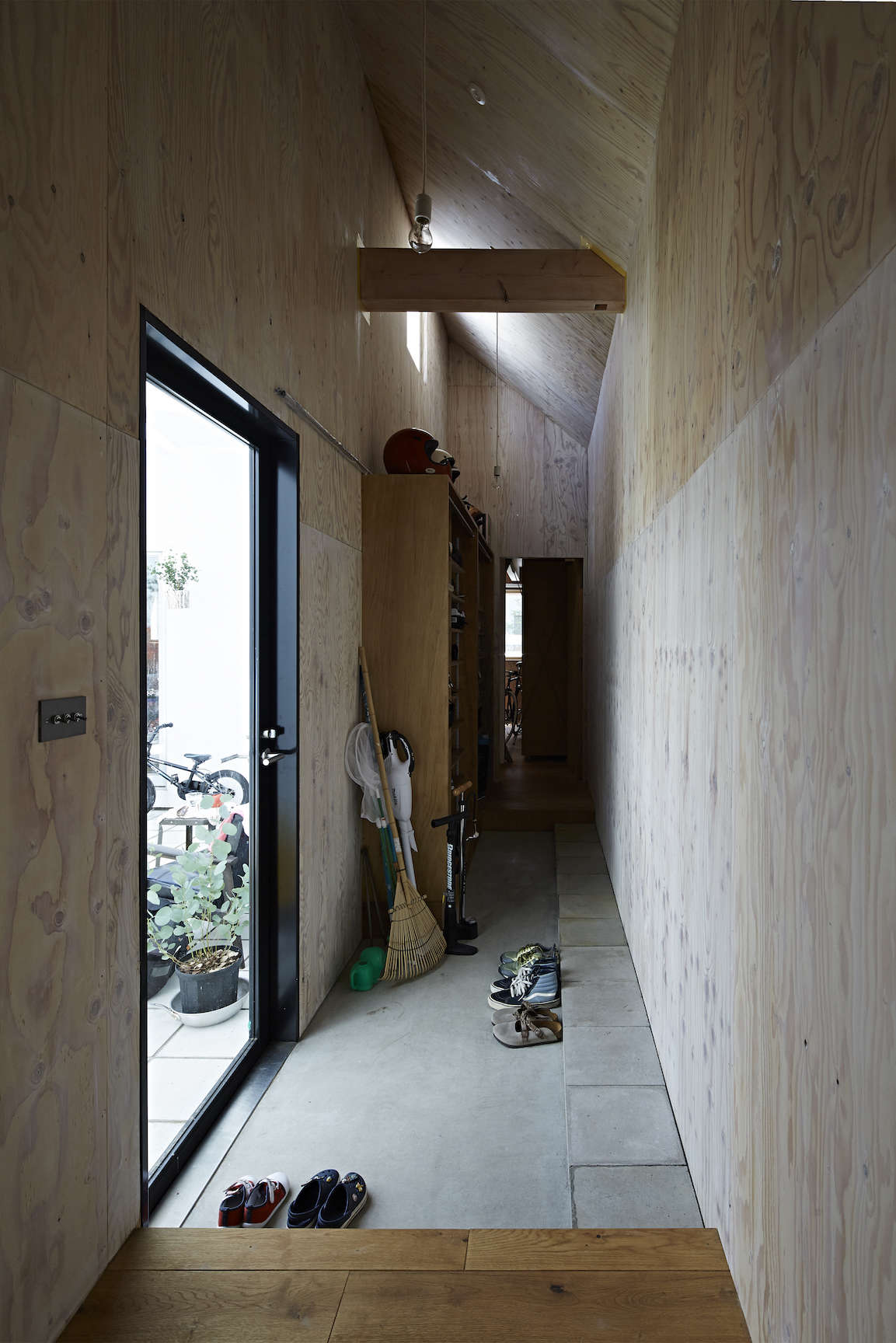 plywood lined entry hall at sabi, a surfers' house in chiba, japan, designed by 17