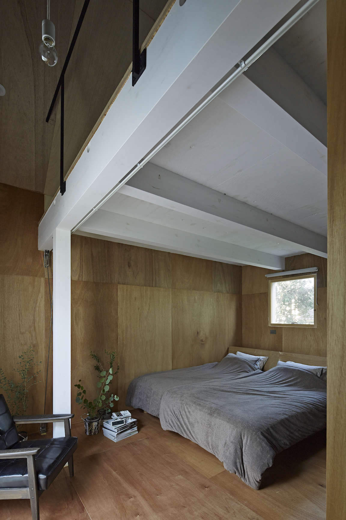 plywood paneled bedroom at sabi, a surfers' house in chiba, japan, designed by  20