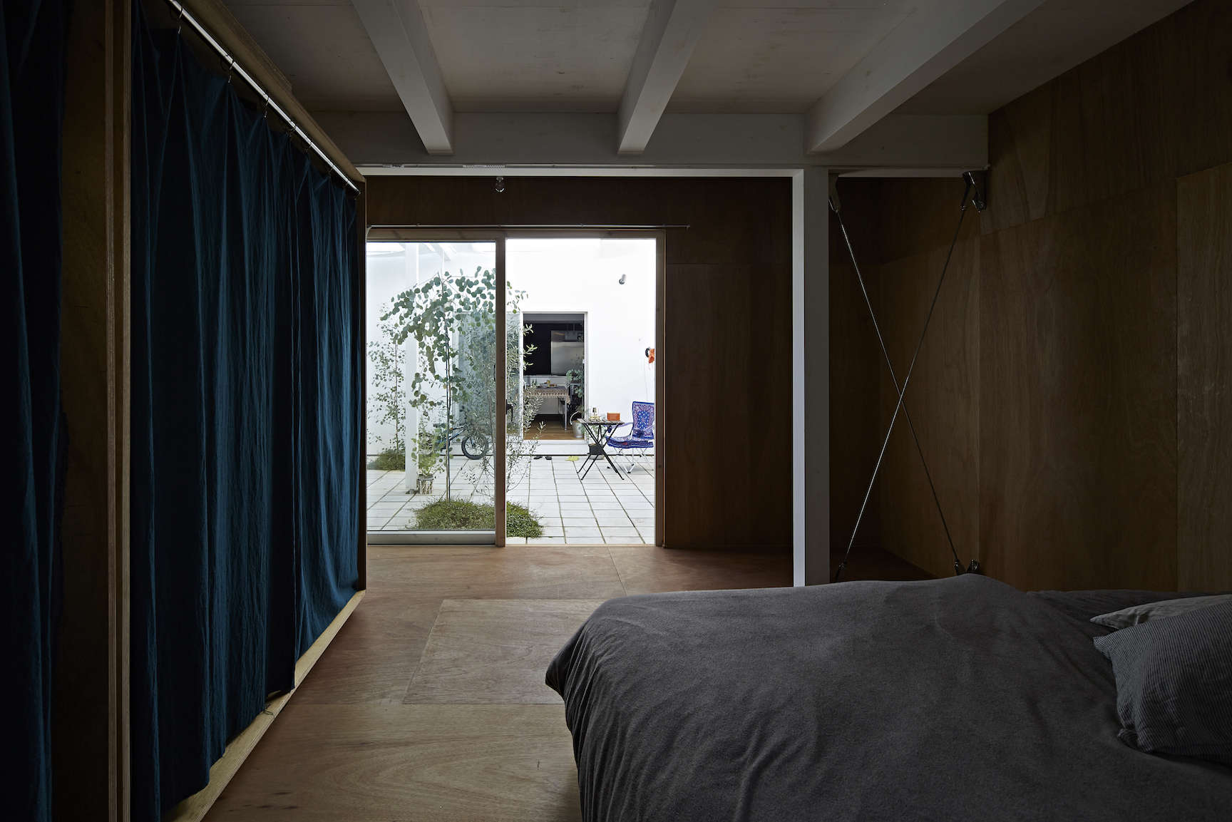 lauan plywood paneled bedroom at sabi, a surfers' house in chiba, japan, design 18