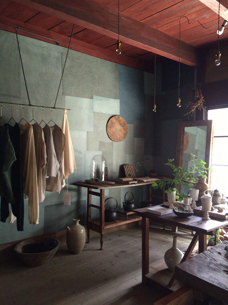 stardust, a boutique and cafe in kyoto. the walls are patterned with paper appl 9