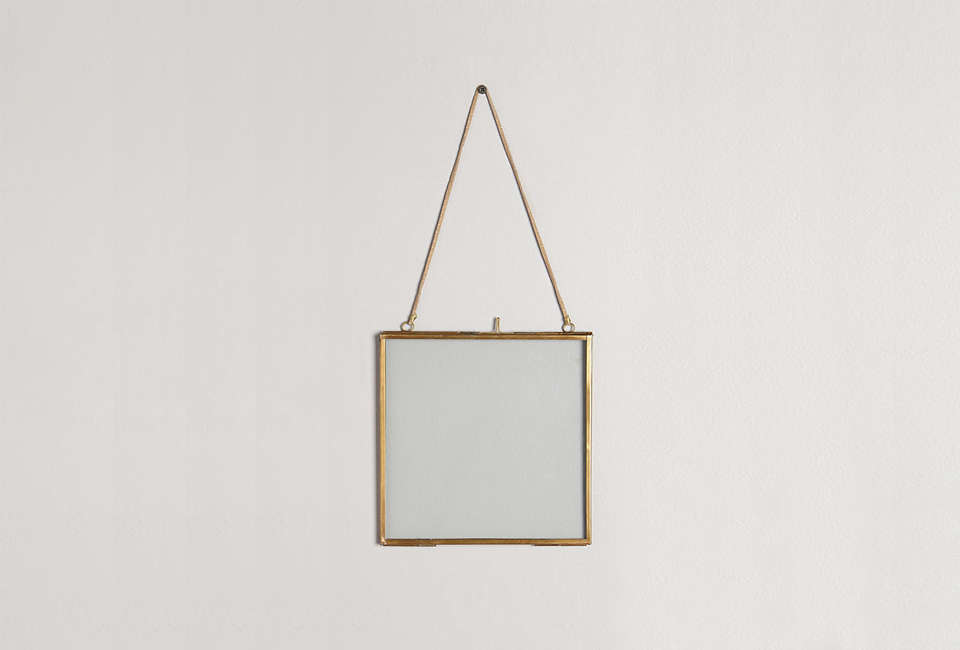 The Viteri Hanging Frame in Bronze is an off-the-rack alternative to the antique wall frames seen here; $ to $58 at Anthropologie.