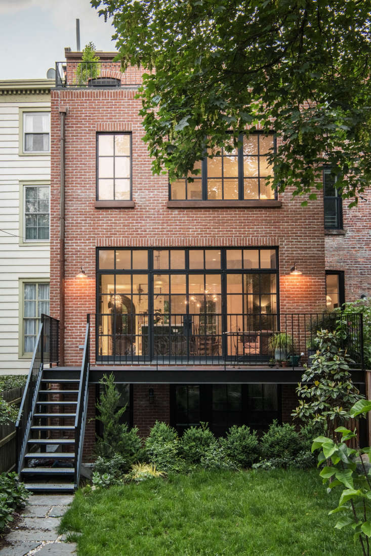 A traditional brick exterior with modern steel windows is classic and timeless. Photograph by Dustin Aksland, courtesy of Elizabeth Roberts Architecture