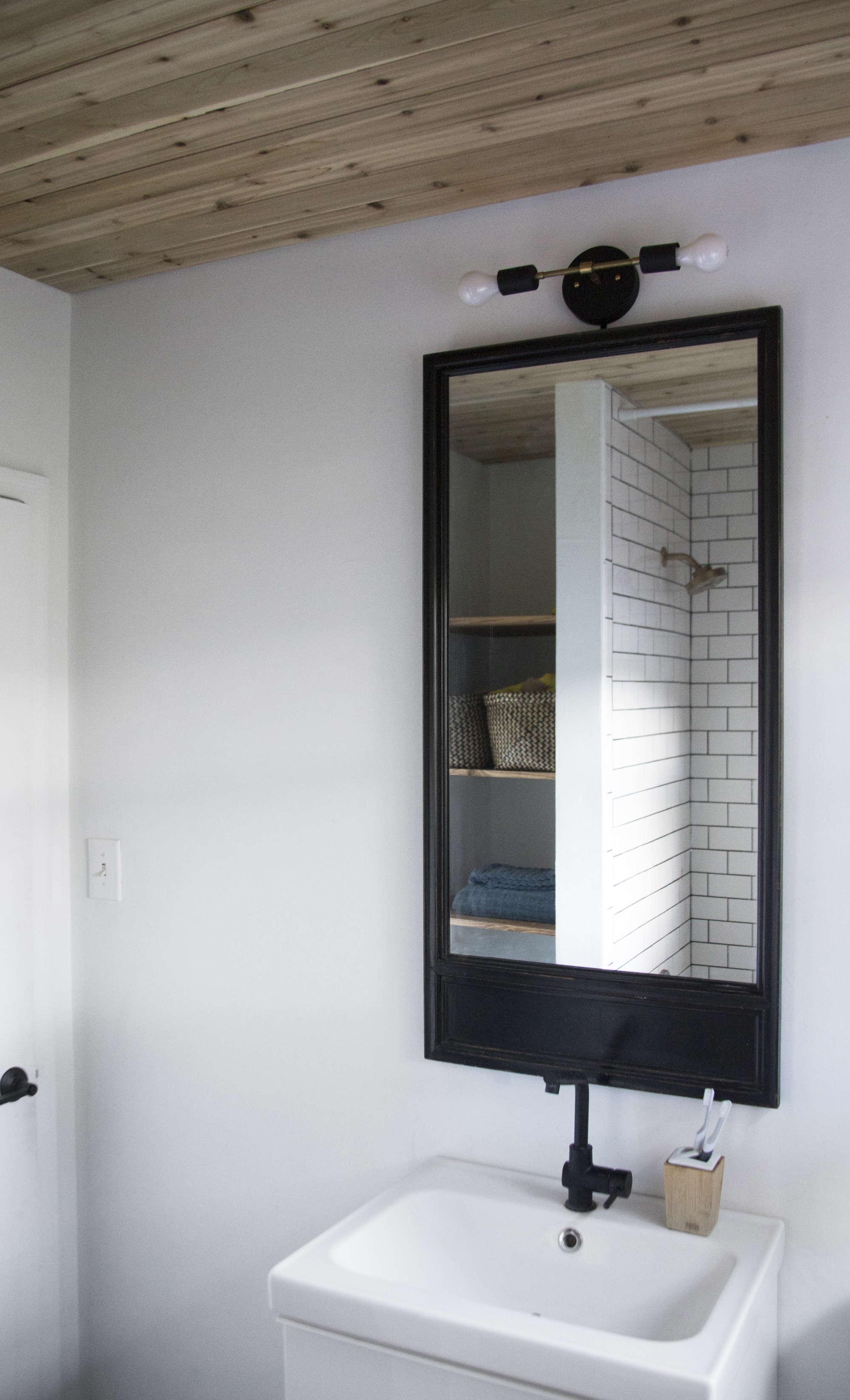 bathroom-budget-remodel-wood-ceiling-black-mirror