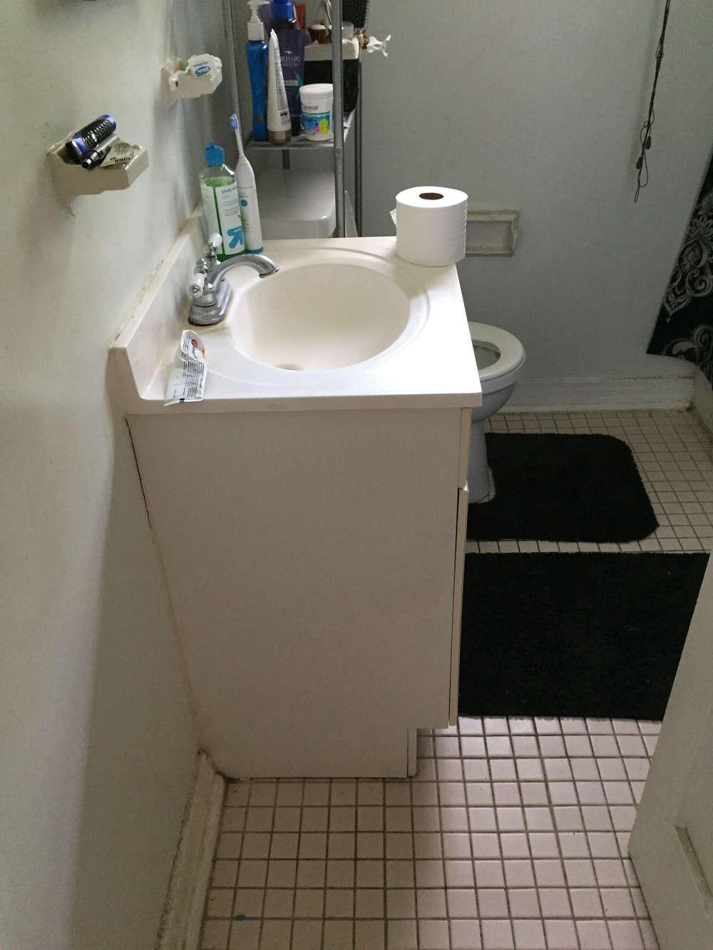 budget-remodel-bathroom-before-photo-white-sink-unit-tile-floor