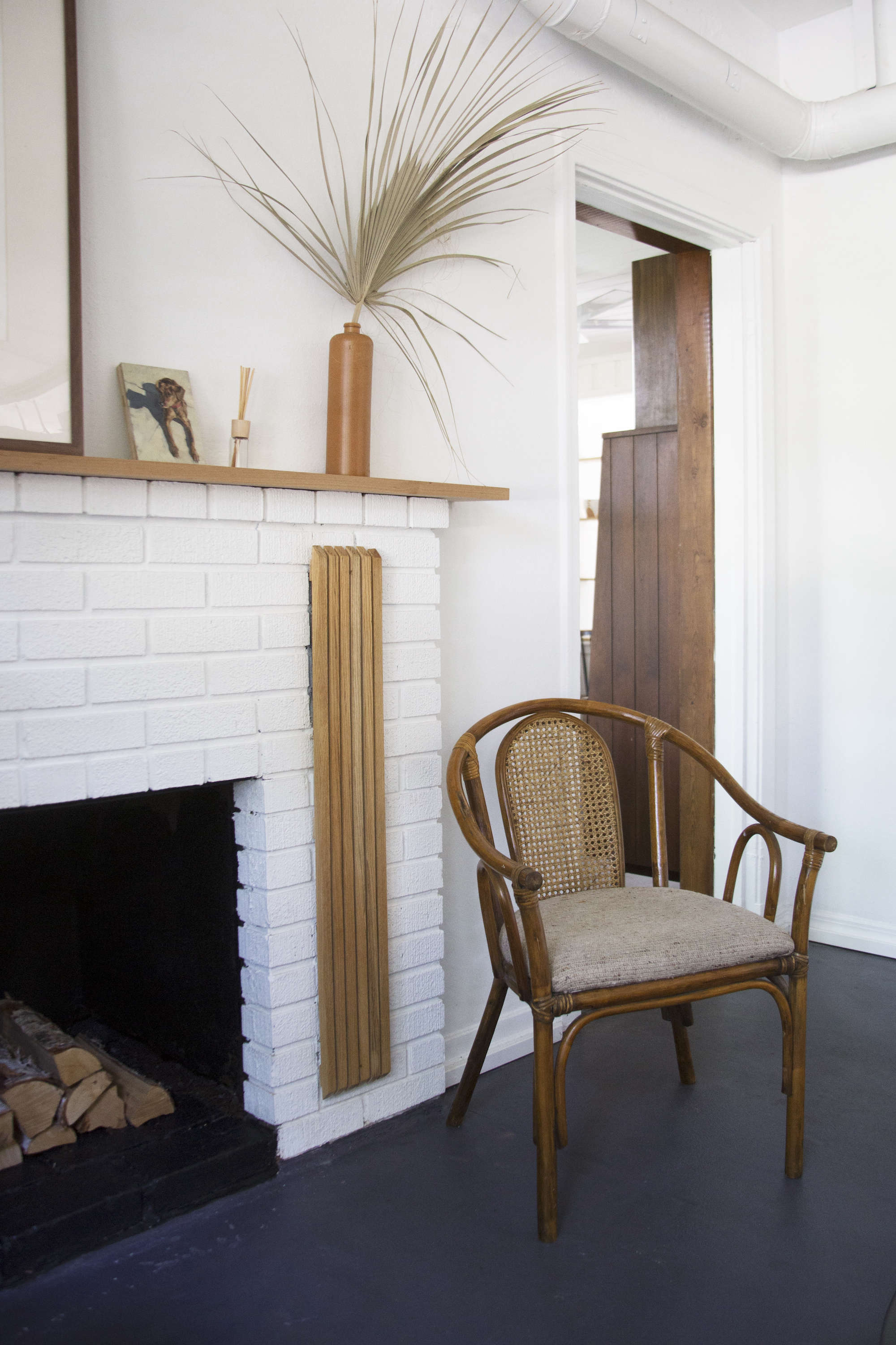 cane-armchair-fireplace-painted-white-budget-remodel-living-room