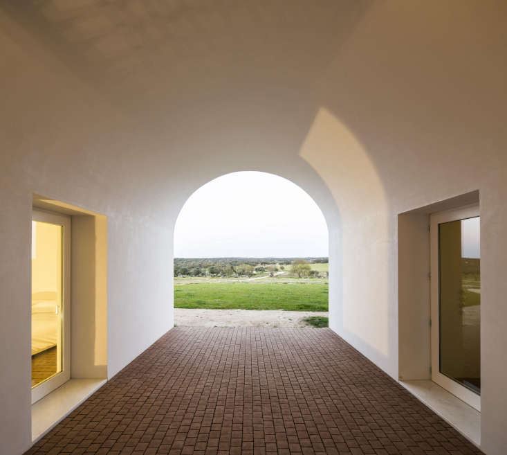 An open air passageway in the center of the building separates the two wingsof the farmhouse.