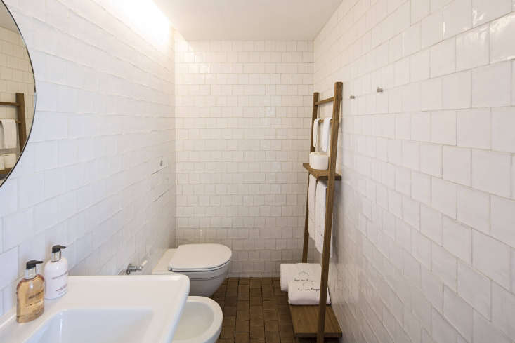 The bathroom has Lefroy & Brooks faucets and fixtures and handmade ceramictiles.