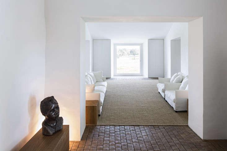 Each room features floor to ceiling windows and windowed doors that overlookthe landscape.