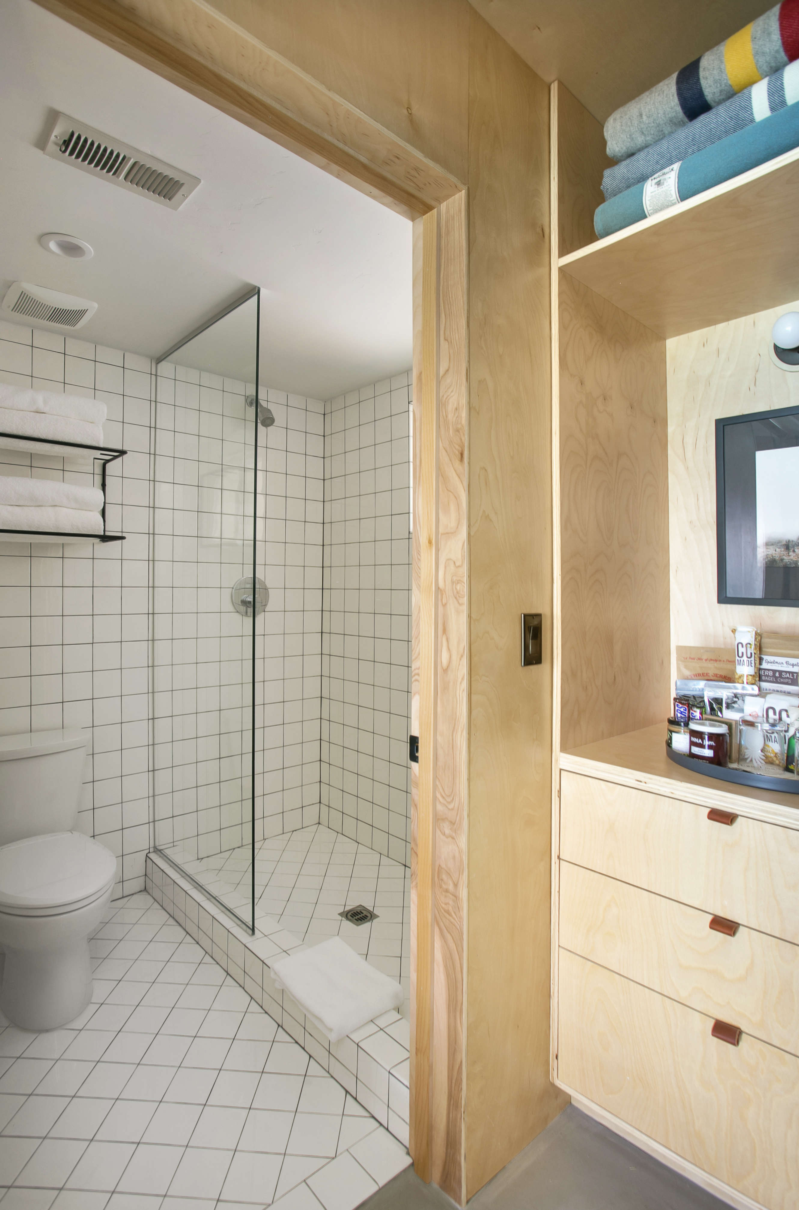coachman-hotel-white-tile-bathroom-with-plywood-entryway