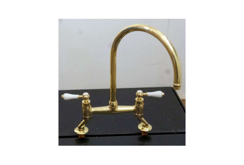 Steal This Look A CostConscious Retro Kitchen in London Cox Architectural Hardware Brass Bridge Faucet