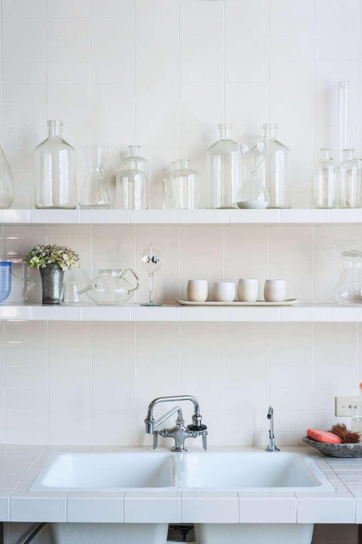 in the shop kitchen of designer christina kim, white tiled shelving displays ar 9