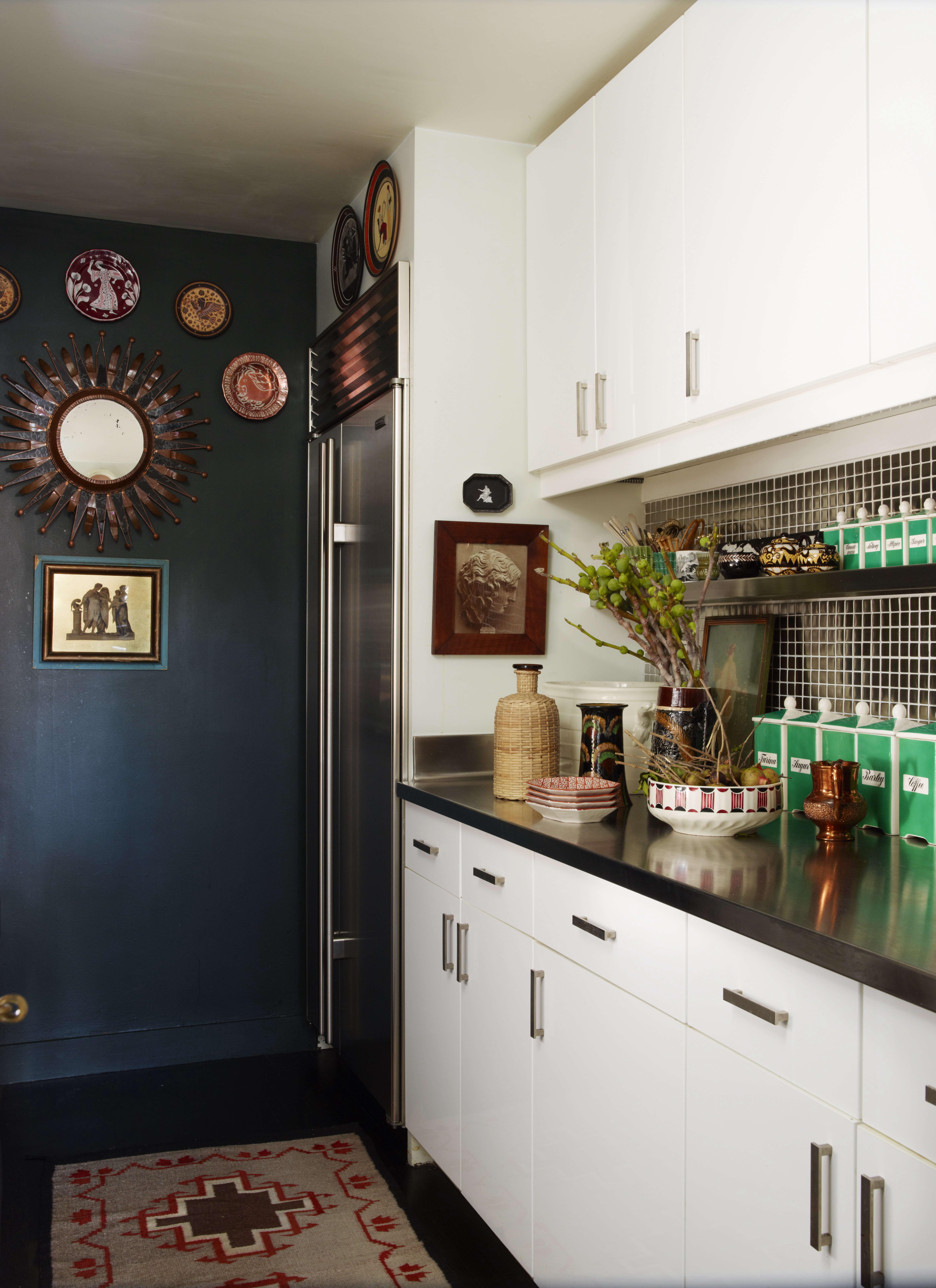 eclectic kitchen blue wall black mini tile native rug 16