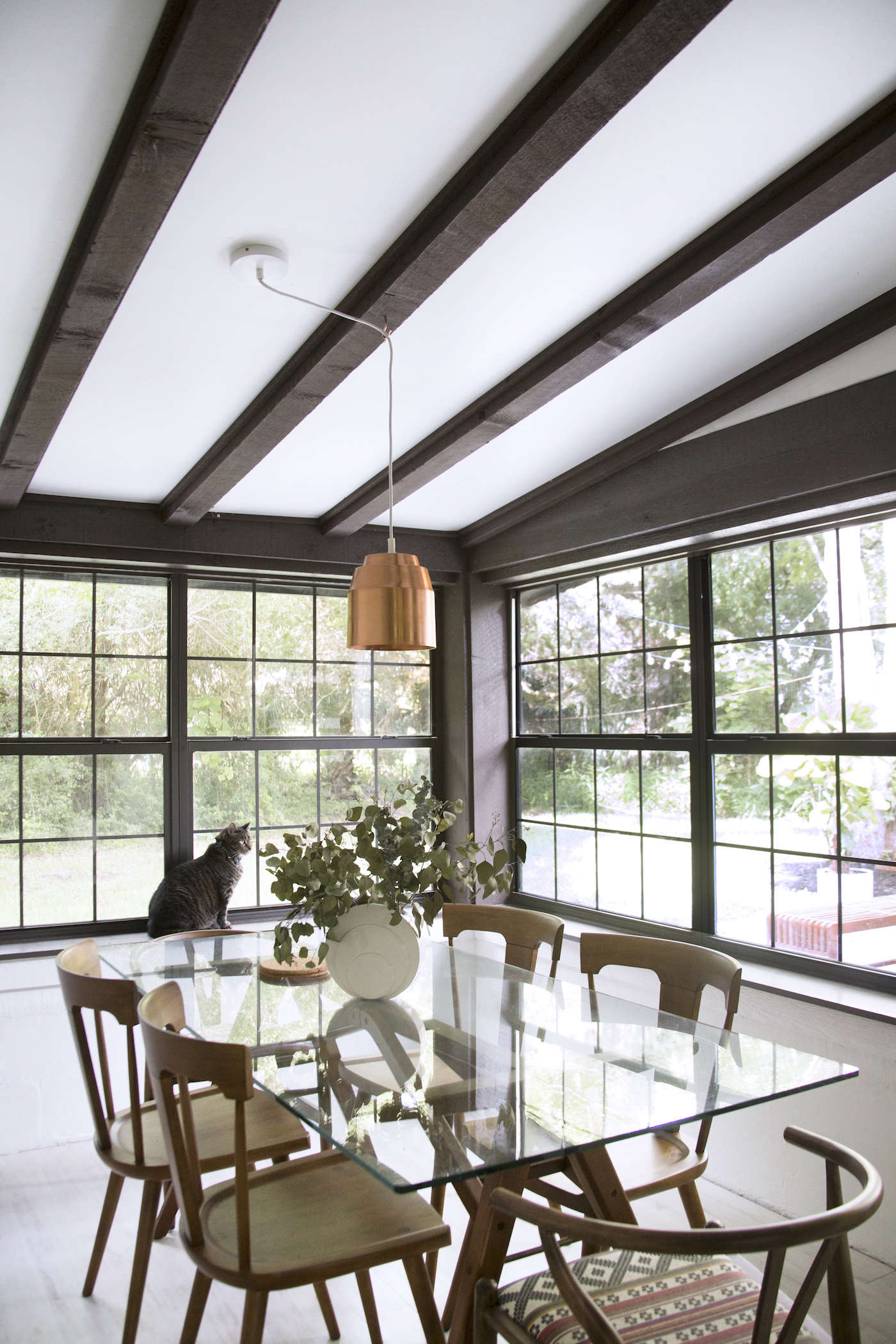 glass-rectangular-dining-room-table-beams-ceiling