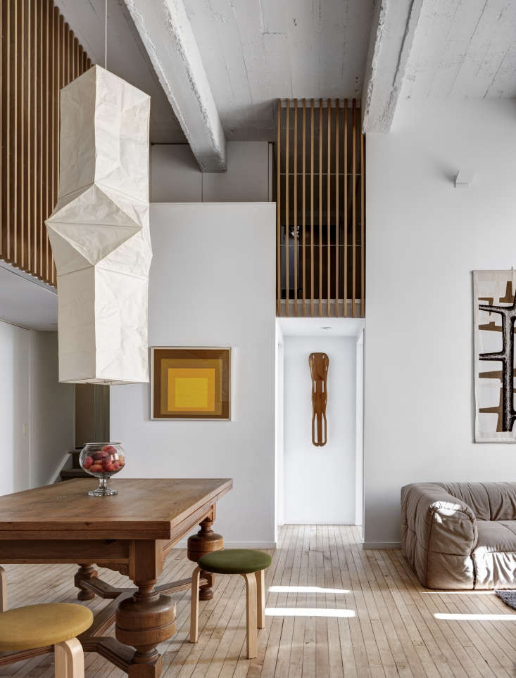 AnAkari Ceiling Lamp, Model L5 from the Noguchi Museum Store hangs in the lofty living area of this Brooklyn apartment. Photograph by Bruce Buck, from An Eclectic Apartment Inspired by Japanese Storage Chests in Cobble Hill, Brooklyn.