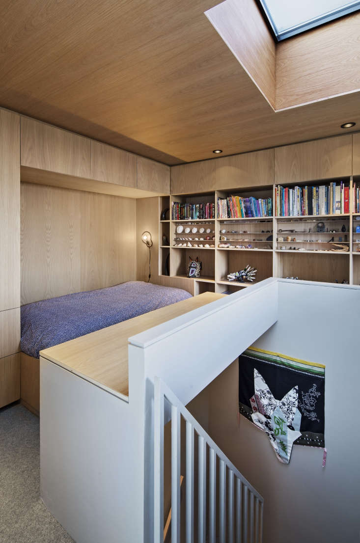 A loft-like bedroom in a Brooklyn apartment is built out with white oak plywood shelving and cabinets and a custom-built bed, to maximize space.See An Eclectic Apartment Inspired by Japanese Storage Chests in Cobble Hill, Brooklyn for more ingenious storage ideas.